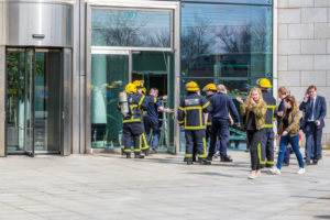 Firefighters outside office building.